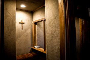 Crucifix hangs inside church confessional